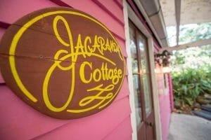 Jacaranda Cottage Timber Sign on Pink Wall 1920 x 1280